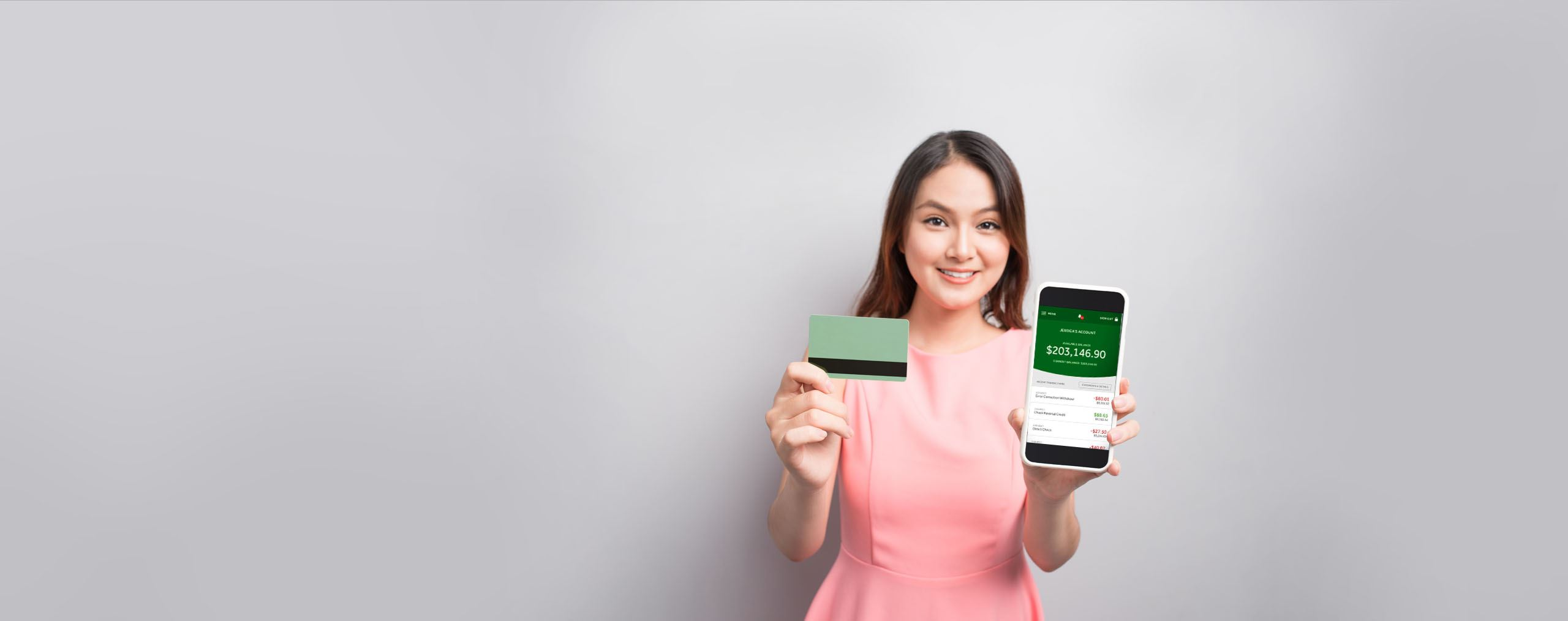 Woman holding phone and credit card
